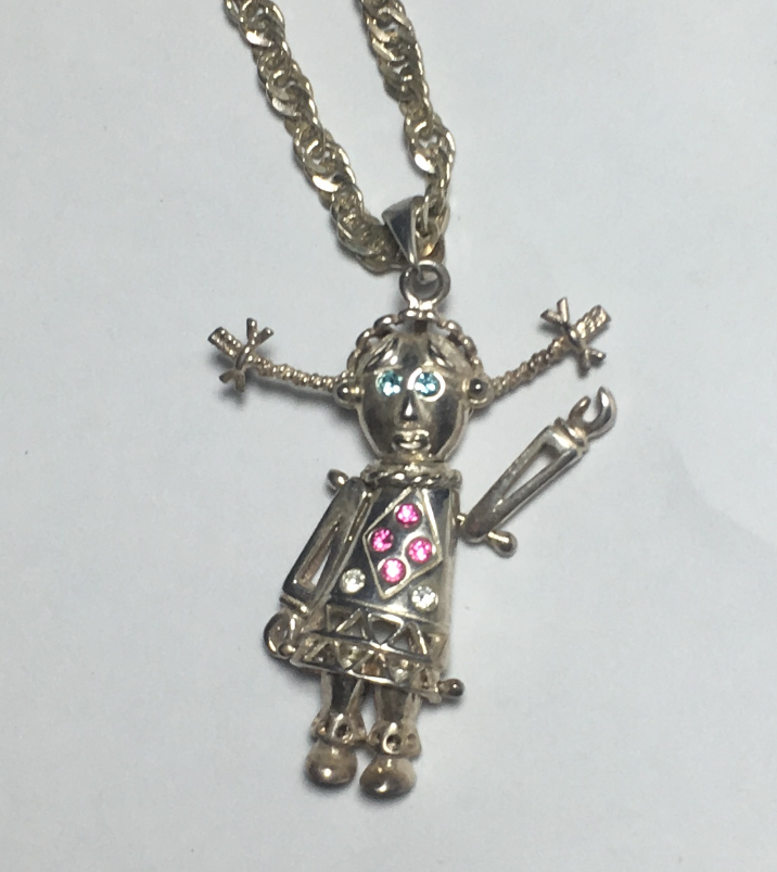 a 925 silver articulated rag doll pendant on a 24 inch