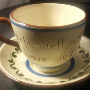 Motto ware cup and saucer